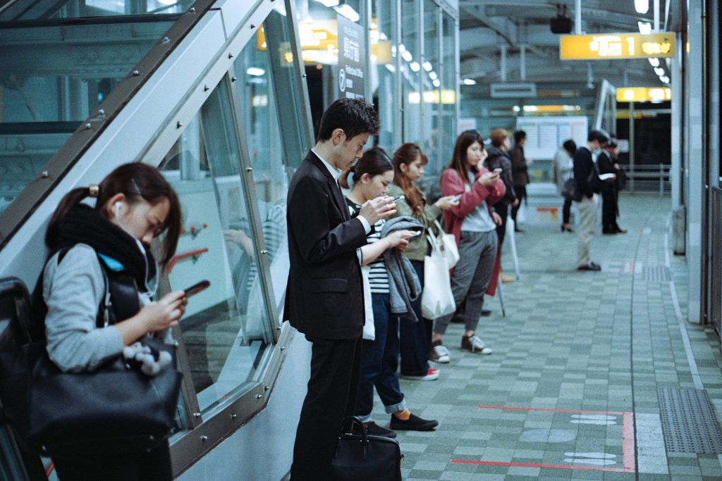 Smartphone Addiction Train Station